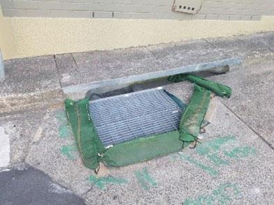 Sand bags around drain