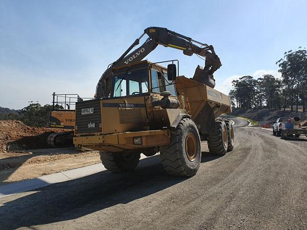 Armpell-Civil-Excavator-loading-A25-Dump-Truck-Eurobodalla