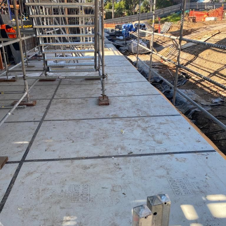Honcho Supplies ultimate concrete protection system - HT Commercial Mat loose laid plus Honcho Chief Board on top