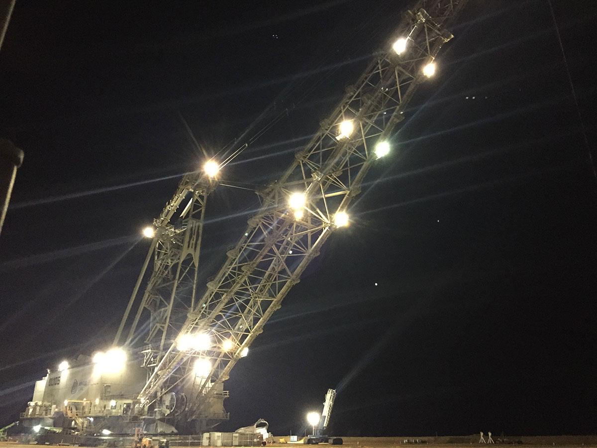 Mobile crane and crawler crane working at night