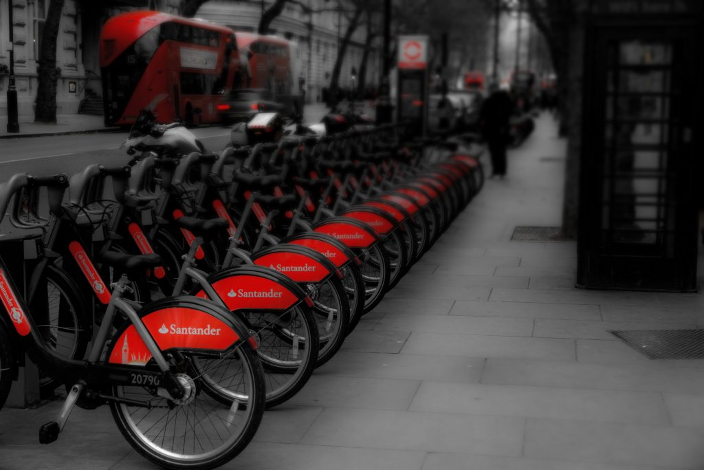A black and white photograph of a row of Santander bikes for hire in London by Norwich based photographer