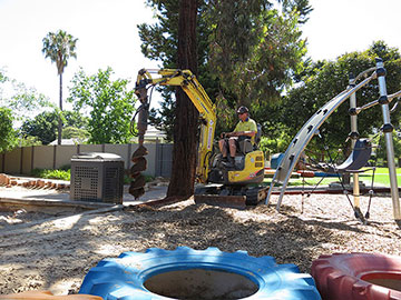 Our Digger Hire Doing Post Hole Digging At A Playground