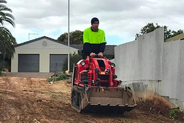 Dingo Mini Loader Hire For Site Levelling And Rubbish Removal