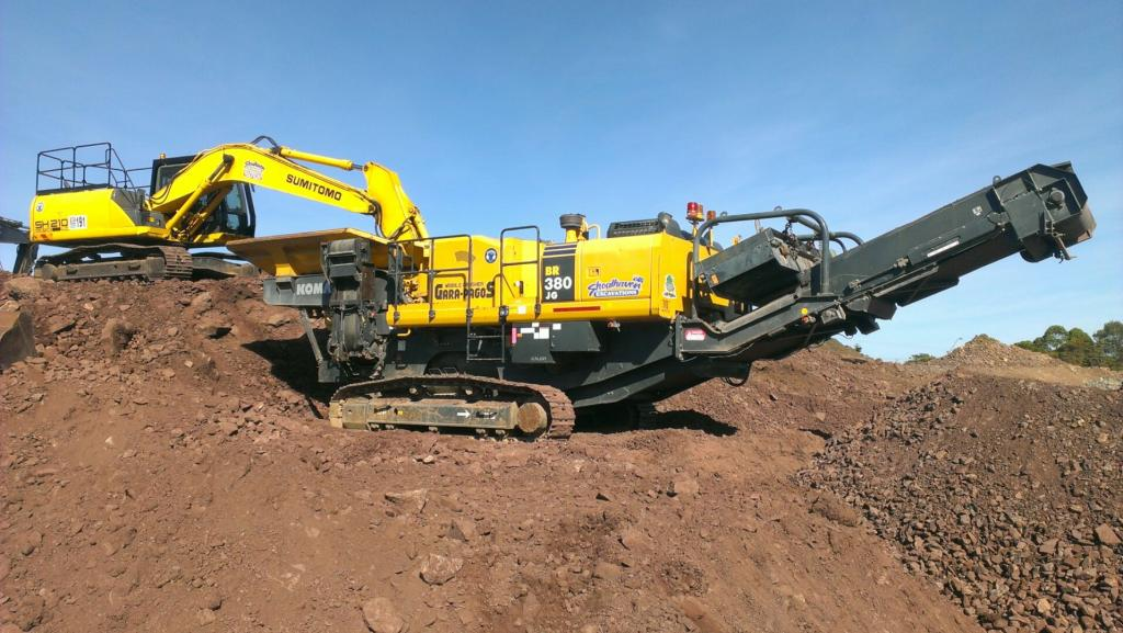 Excavator and crusher on site
