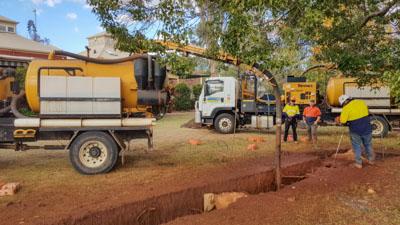 Ezali Hydro Excavation & Communications sucker trucks on road at site in Toowoomba