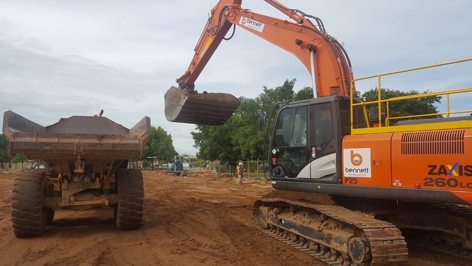 Bennett Plumbing and Civil excavator and ute