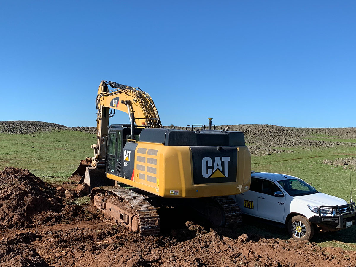 Fletcher-Bros-Solutions-ute-and-excavator-on-site-Plant-Equipment-Hire-Melbourne-Services
