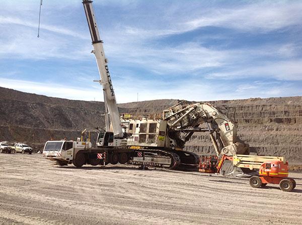 Rough Terrain-crane-and-large-excavator-at-quarry-site