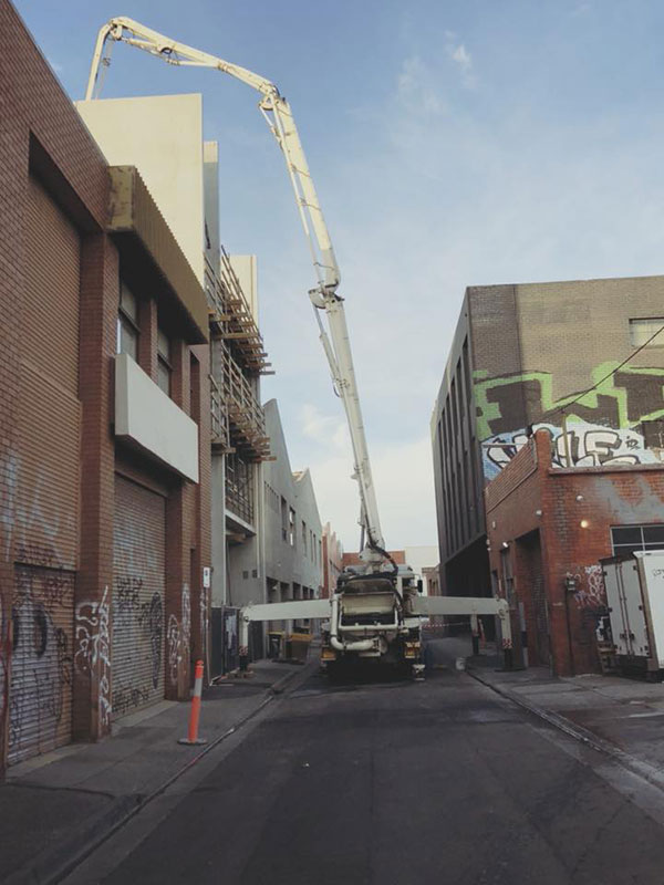 Get-Pumped-Concrete-Pumping-Highrise-Concrete-Boom-Pump-Hire-commercial-concrete-pumping-melbourne