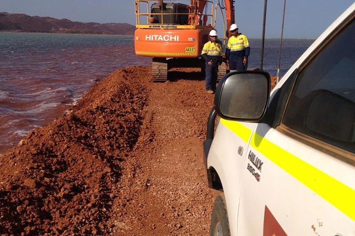 Hicks Civil and Mining Excavator on sea wall Pilbara
