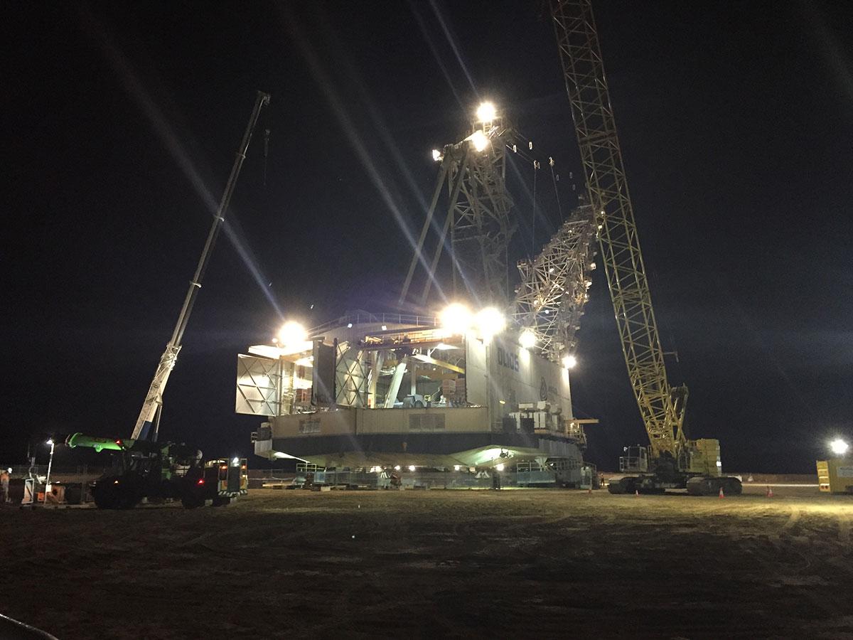 crawler crane at night on site