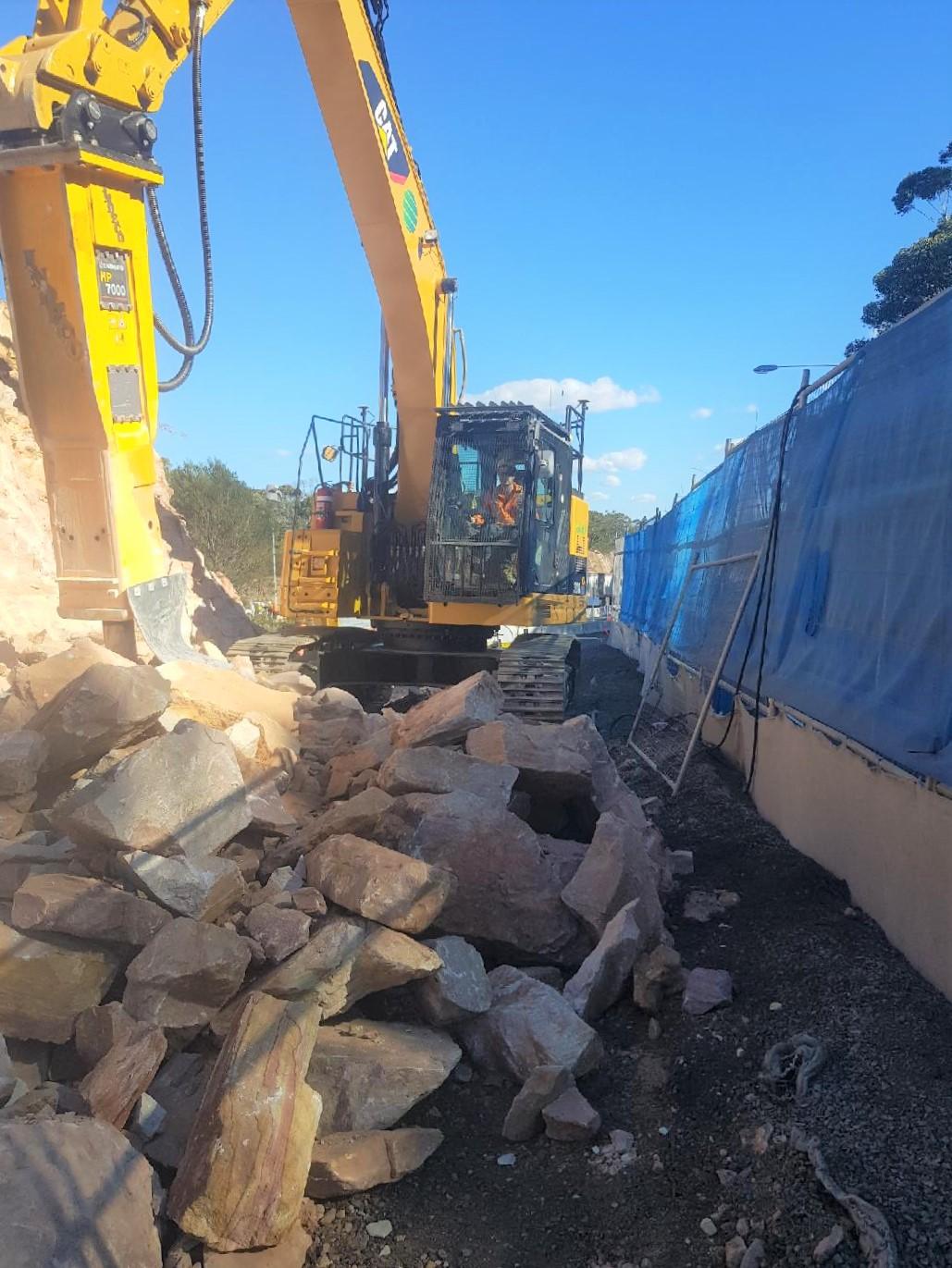 OCON Services Caterpillar excavator on site