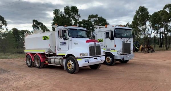Water truck and Kenworth K104