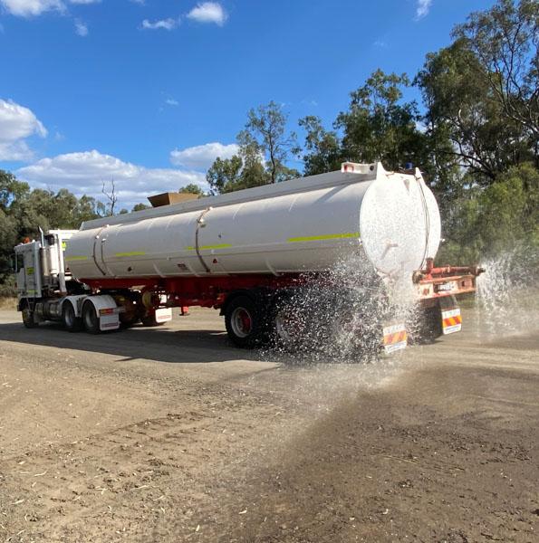 Kenworth K104 towing 30,000L water trailer