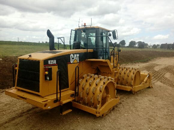 OCON Services CAT compactor from back