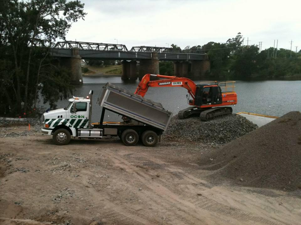 OCON Services Doosan excavator loading dump truck