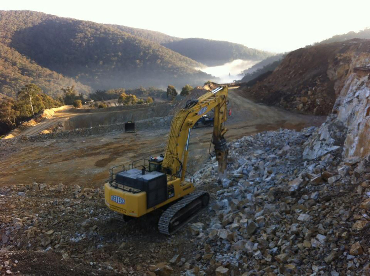Peters Earthmoving Excavator with rock hammer attachment