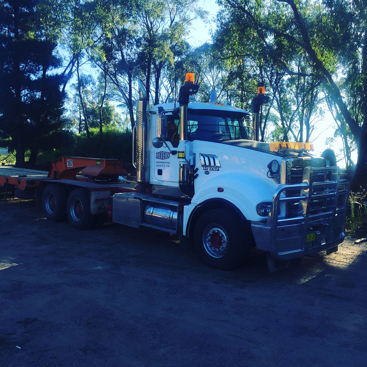 Peters Earthmoving road truck with float