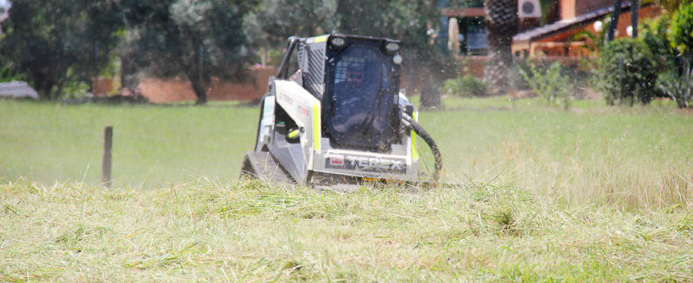 Sustainable Land Clearing Solutions Posi-Track Loader in action