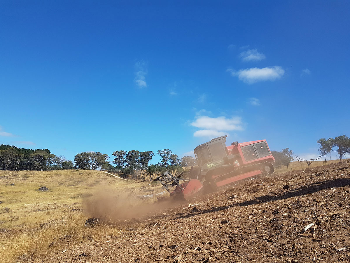 Sustainable Land Clearing Solutions chipper on site