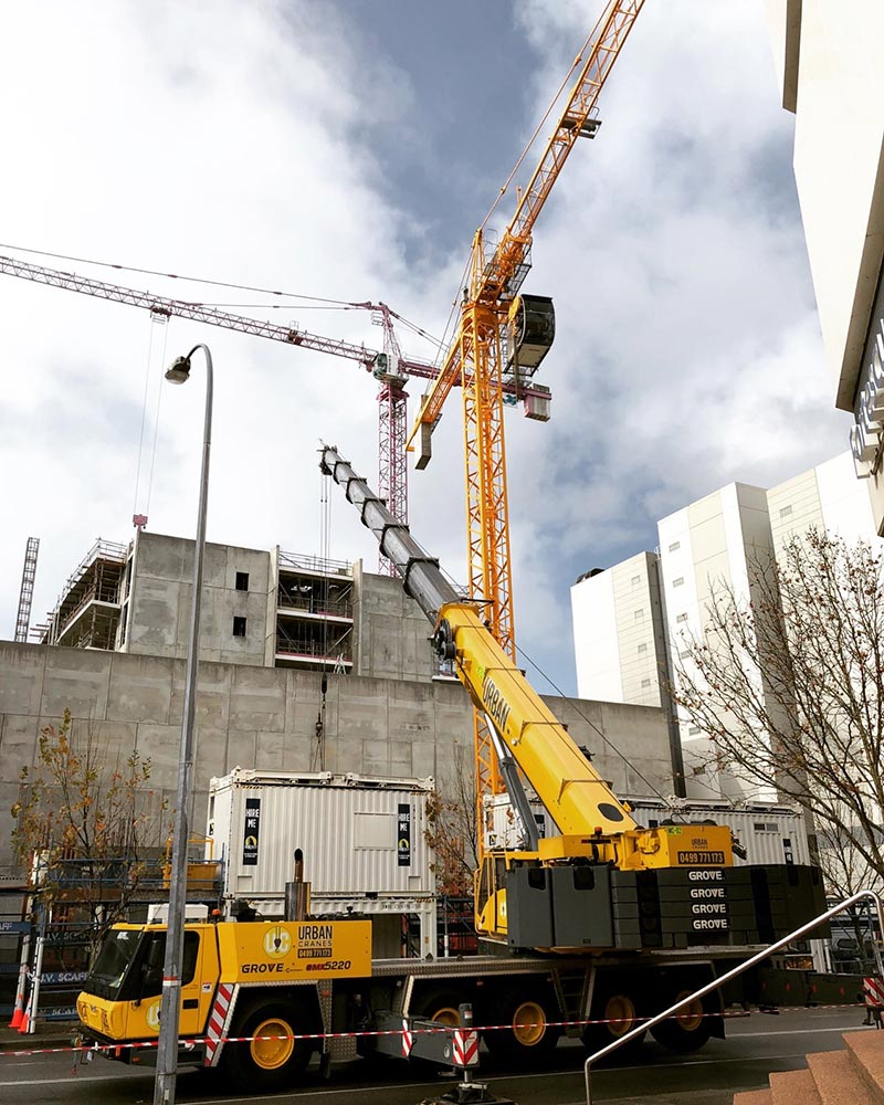 Franna and tower cranes on site