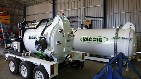 Vac Dig Vacuum Excavators tanks in shed with logo
