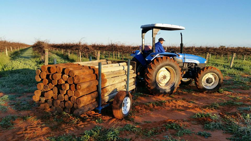 Vine Sight tractor carrying trellis posts