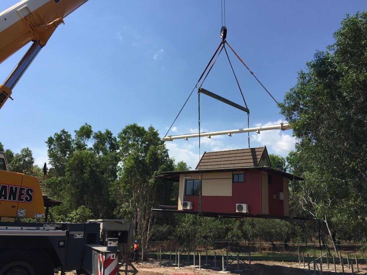 A.M. Cranes & Rigging lifting prefab building