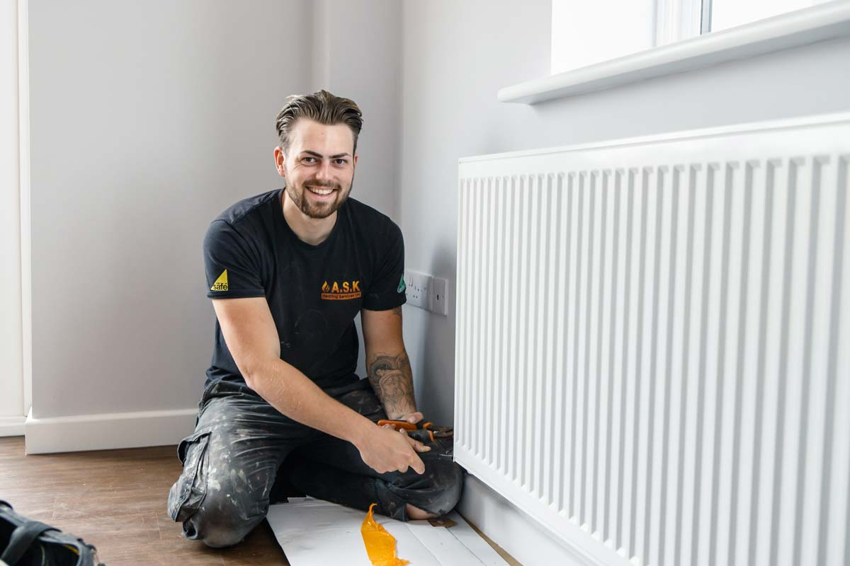 Liam, heating engineer at A.S.K Plumbing and Heating Ipswich, repairing a radiator