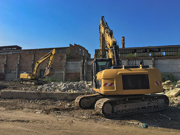 Attcall Civil Contractors Asbestos removal specialists using excavators for demolition in Sydney and Newcastle
