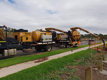 Ezali Hydro Excavation & Communications sucker trucks on road at site in Toowoomba