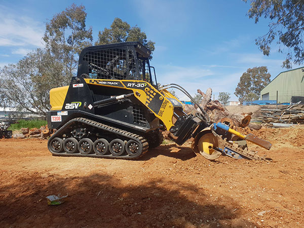 Track loader with trenching attachment for hire