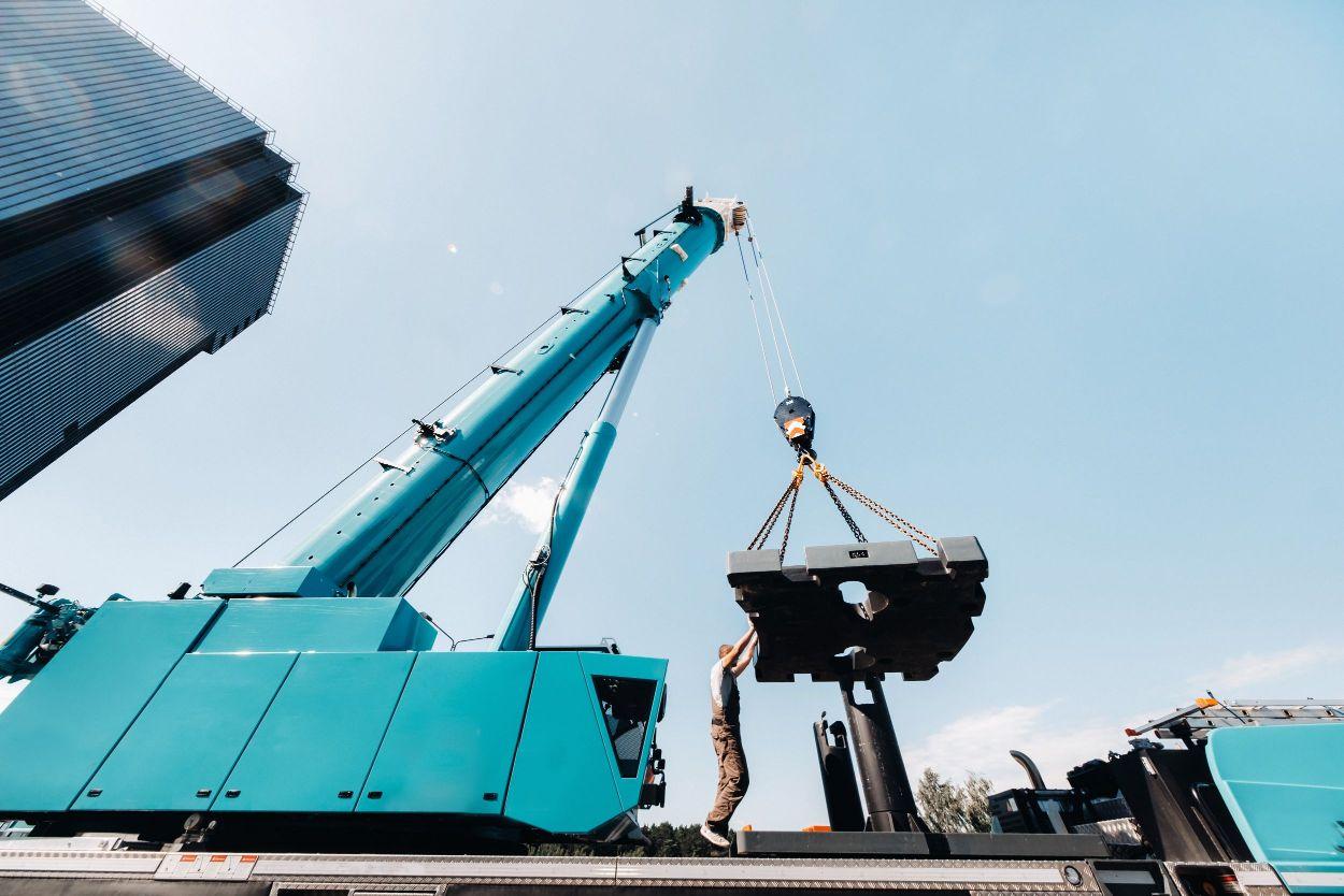 Crane lifting a large block