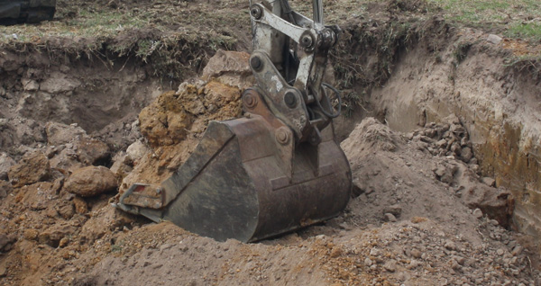 Latrobe Excavations Excavator with Tilting Mud Bucket Attachment operating in Rosedale