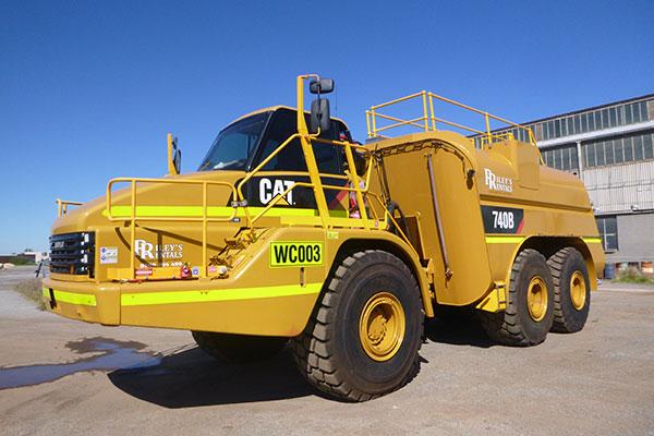 2015 Caterpillar 740 dump truck mounted water carts